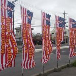 CarMan Nobori Flags outside lot